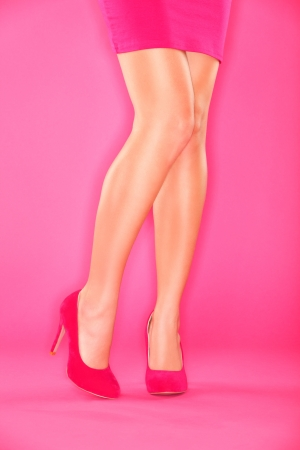 Sexy legs and shoes. Woman leg and pink high heels closeup on pink background. Stock Photo - 15781510