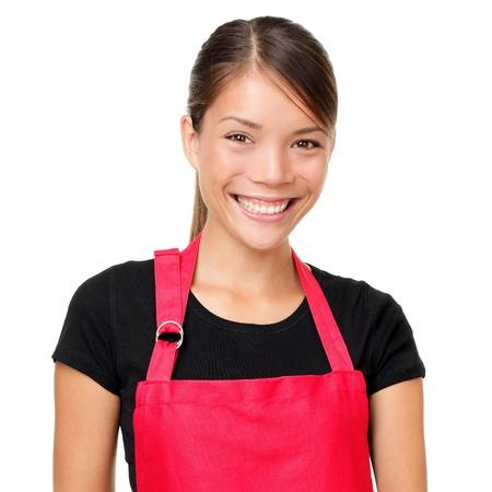 Kleine Unternehmer Porträt isoliert Porträt der jungen Unternehmerin trägt Schürze Mixed-Rennen asiatischen chinesischen kaukasischen weiblichen Ladenbesitzer oder gleichermaßen isoliert auf weißem Hintergrund Standard-Bild
