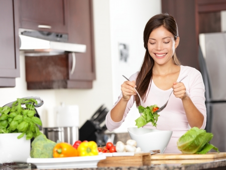 beautiful salad: Woman making salad in kitchen  Healthy eating lifestyle concept with beautiful young woman cooking in her kitchen