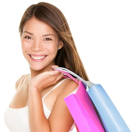 Femme Shopper Shopper fille tenant des sacs à provisions holding shopping bags souriants heureux et joyeux fraîche Belle métisse chinoise modèle asiatique caucasienne achats féminin isolé sur fond blanc Banque d'images - 15892014