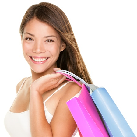Shopper woman holding shopping bags  Shopper girl holding shopping bags smiling happy and fresh  Beautiful cheerful mixed race Caucasian   Chinese Asian female shopping model isolated on white background  Stock Photo