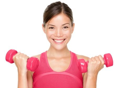 Fitness vrouw gelukkig houden halter gewichten lachend geà ¯ soleerd op witte achtergrond Mooie multiculturele gemengd ras Aziatische Kaukasische vrouwelijke sport fitness model Stockfoto