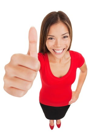vivacious: Thumbs up woman  Fun high angle full body portrait of a vivacious laughing woman giving a thumbs up gesture of approval as she looks at camera, isolated on white background  Mixed race businesswoman