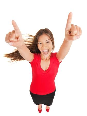 Femme réussie applaudir en liesse en riant et en pointant ses mains vers le ciel Banque d'images