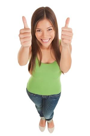 찾고 청바지에 행복 한 미소 젊은 여자의 높은 각도의 관점
