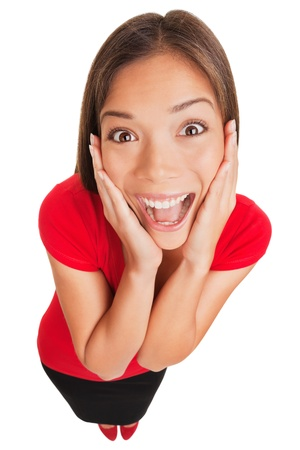 Joyful excited surprised young woman holding her hands to her cheeks smiling up Standard-Bild