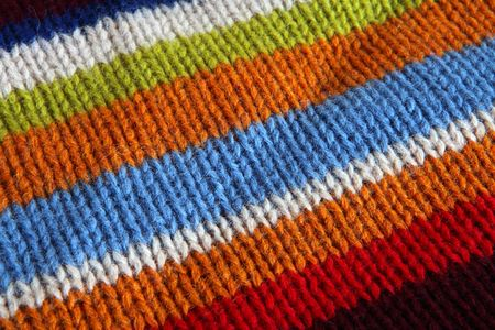 Colourful knitted scarf close up. photo