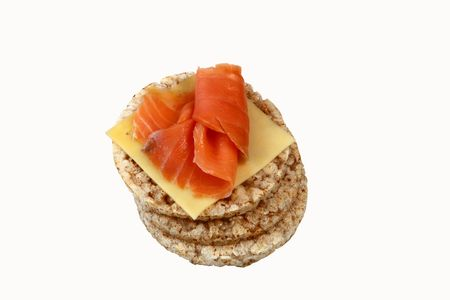 fresh food fish cake: thin rice cakes with smoked salmon and cheese isolated on white background