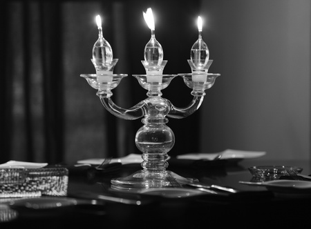 Candle lights on the table in the restaurant, b&w photo