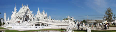Chiang Rai, Thailand - Jan 17, 2017: Wat Rong Khun, perhaps better known to foreigners as the White Temple, is a contemporary, unconventional, privately-owned art exhibit in the style of a Buddhist temple in Chiang Rai Province, Thailand.