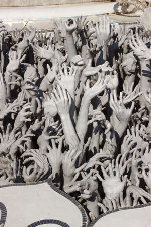 Hands Statue from Hell in Wat Rong Khun at Chiang Rai, Thailand Stock Photo