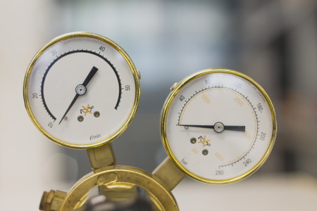 Pressure Gauge tool equipment, pressure gauge on a gas regulator in a laboratory analytical equipment. Stock Photo