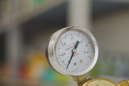 Pressure Gauge tool equipment, pressure gauge on a gas regulator in a laboratory analytical equipment.