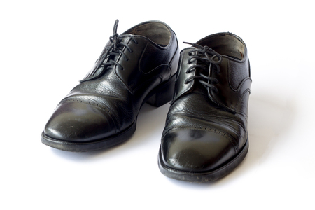 Old men's leather shoes on white background. Stock Photo