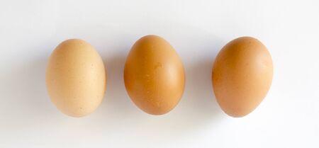 Fresh Chicken Eggs on white background.