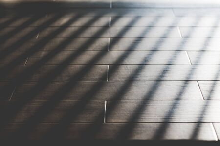 Light and shadow on wooden background. Archivio Fotografico