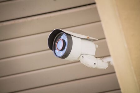 Camera security on the wall of the building.
