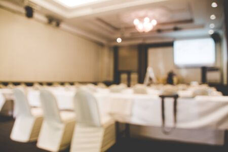 Meeting room blur background, blurred image of empty banquet hall,  blurred background of party. Archivio Fotografico