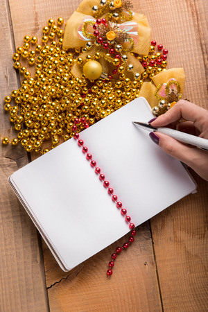 personal perspective: Conceptual,notebook on a wooden table. open diary and pen with new year goals 2017