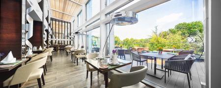Modern restaurant interior on balcony, part of a hotel 스톡 콘텐츠