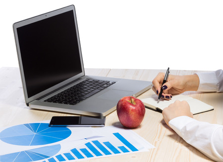 Business woman in an office holding red apple - Clipping Path Stock Photo