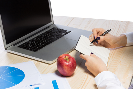 notebook computer: Business woman in an office holding red apple - Clipping Path Stock Photo
