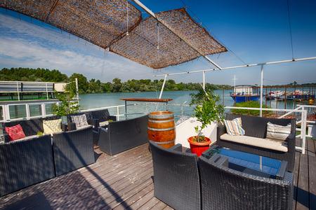 sunshade: summer outdor restaurant on the river bank