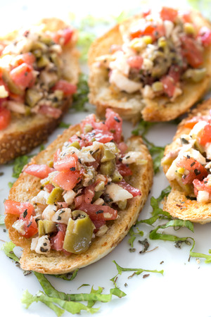 caper: Bruschetta with roasted bell pepper,capers and basil