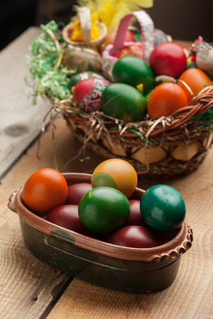 Easter eggs and natural wooden country table, background and texture Stock Photo
