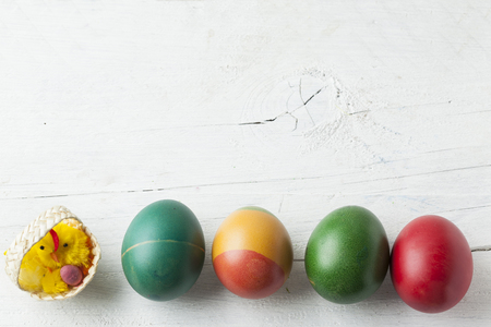 Easter eggs and white wooden country table, background and texture, copyspace Stock Photo