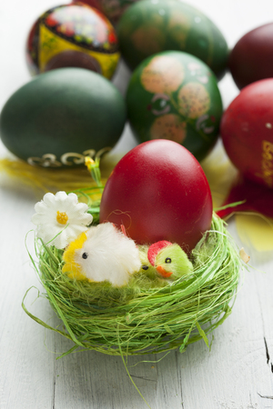 Easter eggs and white wooden country table, background and texture