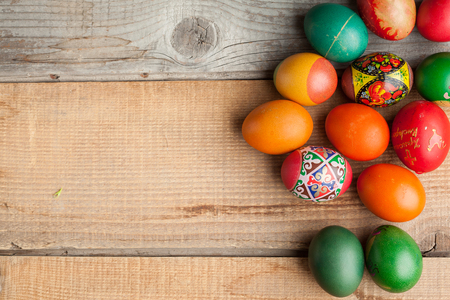Red easter eggs on old wood table, copyspace