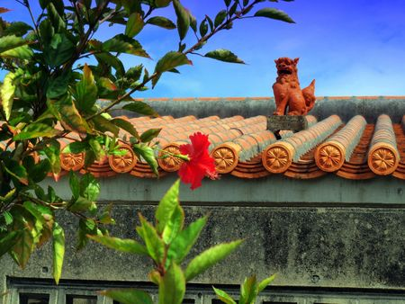 protects: Shisa on a traditional Okinawan roof.