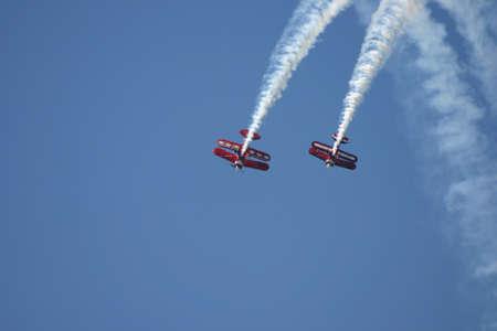 looping: Biplanes performing a looping Editorial
