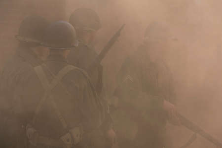 soldiers: US soldiers covered by smoke