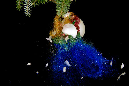 Christmas ball exploding. Glitter falling out. Stock Photo