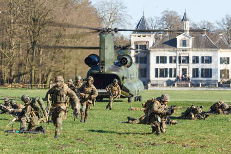 Olst Feb 7 2018: Army and Air Force helicopter exercise. Chinook landing to drop soldiers