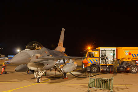 Leeuwarden Feb 6 2018: Night flight Exercise. F-16 Fighting Falcon is being refueled for the next mission. Redactioneel