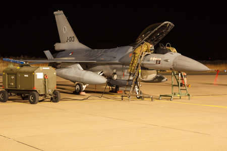 Leeuwarden Feb 6 2018: Night flight Exercise. Mechanics inspecting an F-16 Fighting Falcon. Redactioneel
