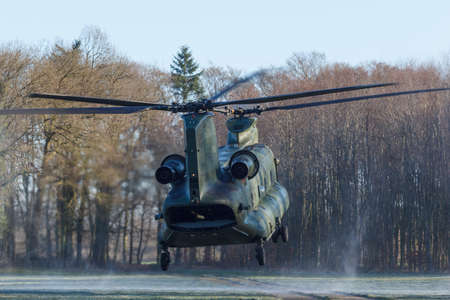 Olst Feb 7 2018: Army and Air Force helicopter exercise Chinook landing to drop soldiers