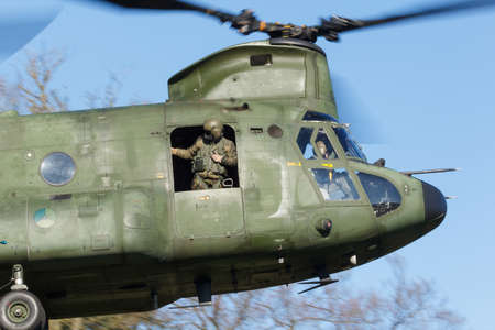 Olst Feb 7 2018: Army and Air Force helicopter exercise. Chinook landing to pick up soldiers Redactioneel