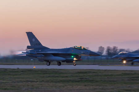 Leeuwarden Feb 6 2018: Night flight Exercise. F-16 Fighting Falcon taking off in the evening sun.