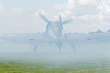 Oostwold, Netherlands May 25, 2015: Corsair covered by smoke at the Oostwold airshow Redactioneel