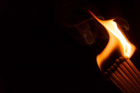 A row of matches is being ignited, spreading the fire