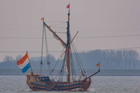 Kampen, The Netherlands - March 30, 2018: State Yacht De Utrecht is sailing to Kampen to attend Sail Kampen