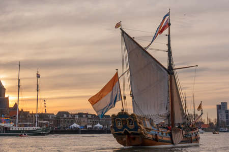 Kampen, The Netherlands - March 30, 2018: State Yacht De Utrecht in front of a sunset at Sail Kampen Editorial