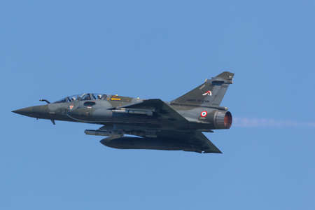 Leeuwarden, Netherlands April 18, 2018: A French Mirage 2000 taking off with after burner during the Frisian Flag exercise Redactioneel