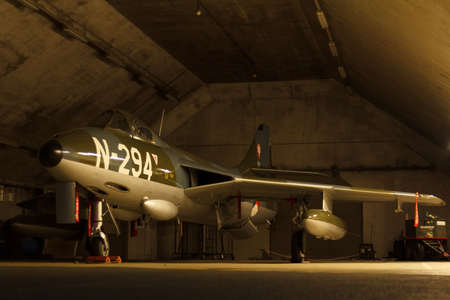 Leeuwarden, The Netherlands, Feb 6 2018: A Hawker Hunter in a dim lit shelter at air firce base Leeuwarden