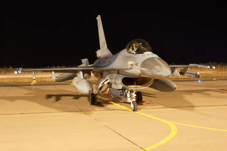Leeuwarden, The Netherlands, Feb 6 2018: A F-16 Fighting Falcon is waiting on the platform for the next night flight Editöryel