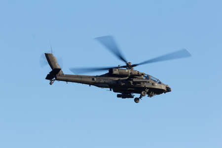 Olst Feb 7 2018: Army and Air Force helicopter exercise. Apache covering pick up zone